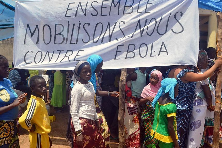 Residents attend an awareness campaign on Ebola by local authorities in western Guinea. The families of every Guinean health worker who has died in the Ebola outbreak will be compensated for their loss with US$10,000, the government said on Oct 22. -
