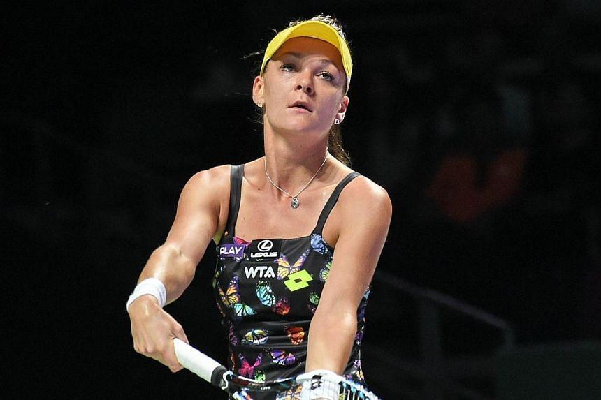 Agnieszka Radwanska of Poland serves against Caroline Wozniacki of Denmark during the Women's Tennis Association (WTA) finals round robin match in Singaporeon Oct 23, 2014. -- PHOTO: AFP
