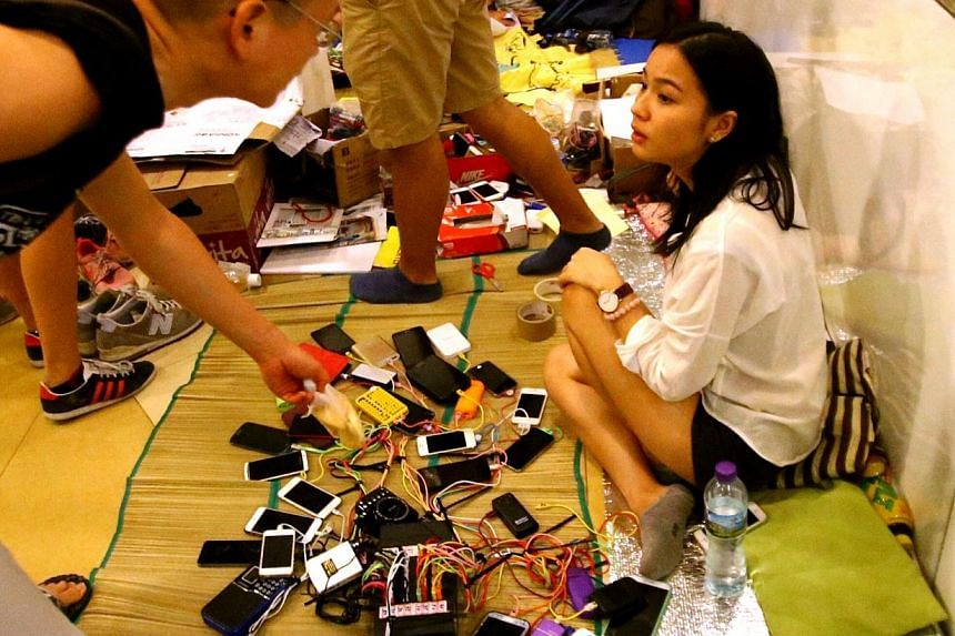 A charging station where hundreds of cables diverge from a mini-generator is used by the protesters of the Occupy Central movement in Hong Kong. -- TNP PHOTO: BENJAMIN SEETOR