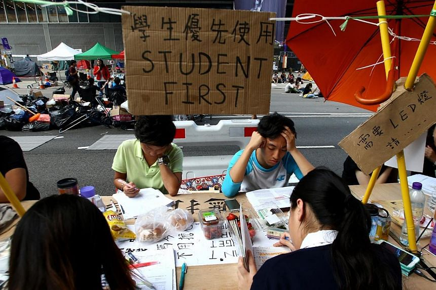 The Occupy Central movement in Hong Kong is largely a student-fueled pro-democracy protest, hence students can be commonly spotted studying at makeshift stations on tables made of wooden crates. -- TNP PHOTO: BENJAMIN SEETOR