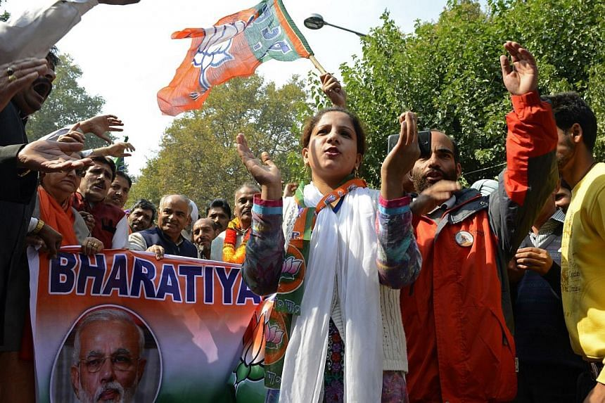 Hindu nationalist Bharatiya Janata Party supporters gesture as they march towards Governor House, where Indian Prime Minister Narendra Modi is scheduled to meet with some flood-affected Kashmiris, in Srinagar on Oct 23, 2014.Indian Prime Minist