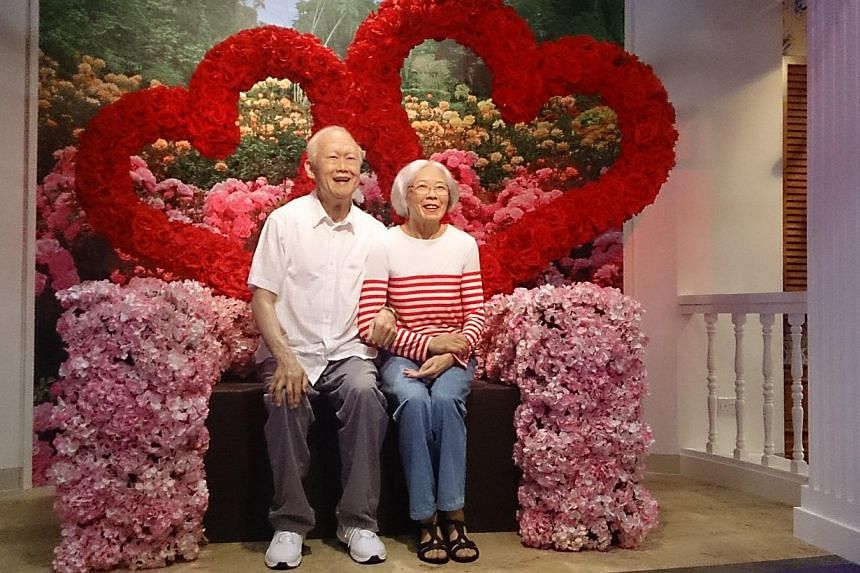Wax figures of former prime minister Lee Kuan Yew and his late wife Kwa Geok Choo have been unveiled at the Madame Tussauds Singapore wax museum, which had its grand opening on Thursday. -- ST PHOTO: DESMOND FOO