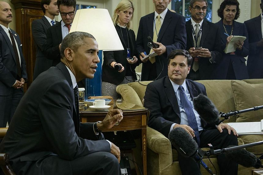 Ebola response coordinator Ron Klain (right) listens while US President Barack Obama makes a statement to the press on the Canadian Parliament shooting after their meeting in the Oval Office of the White House in Washington, DCon Oct 22, 2014.