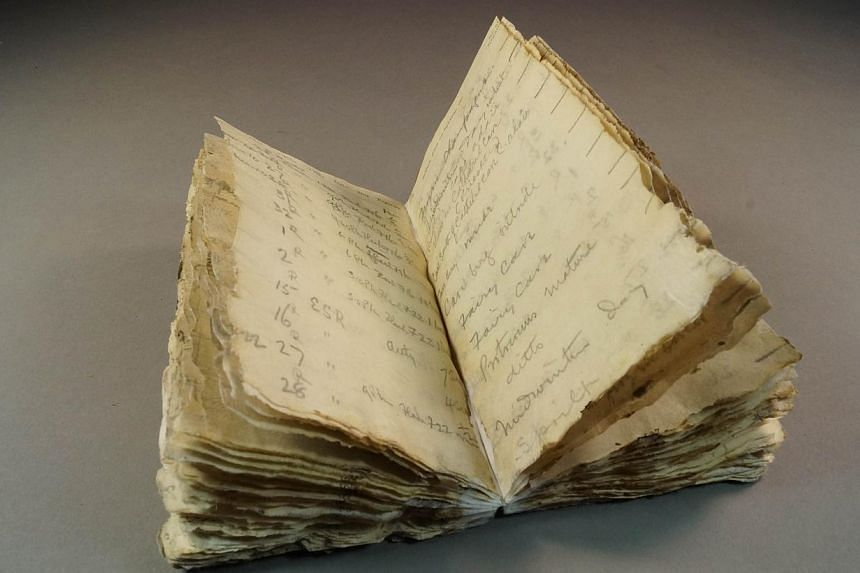 An undated handout photo from Antarctic Heritage Trust (NZ), released on Oct 23, 2014 shows a notebook from Robert Scott's ill-fated Antarctic expedition which was found after a century trapped in the ice of the frozen continent. -- PHOTO: AFP