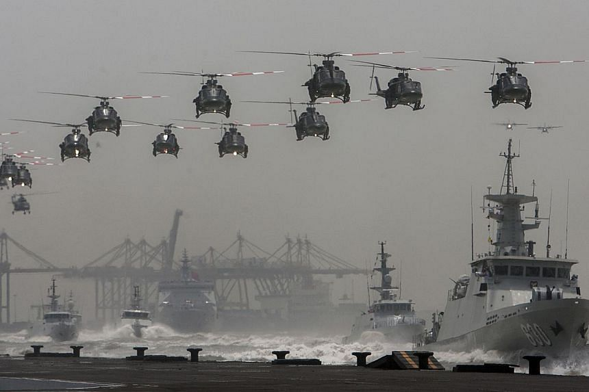 Indonesian helicopters and navy ships in formation at an event earlier this month. President Joko promised during his campaign to have a maritime policy that safeguards Indonesia's economy and defence.