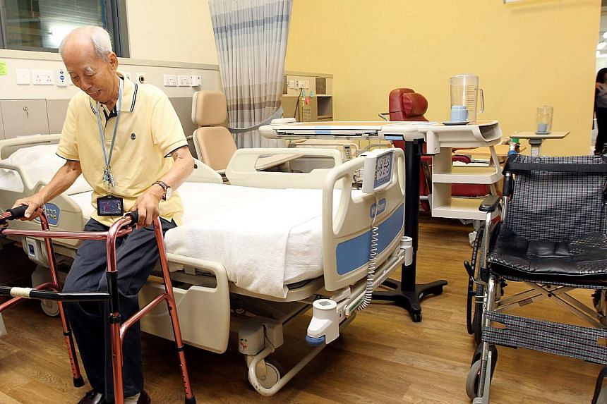 A stroke patient using crutches to go to the toilet from the hospital bed of a ward. -- PHOTO: ST FILE