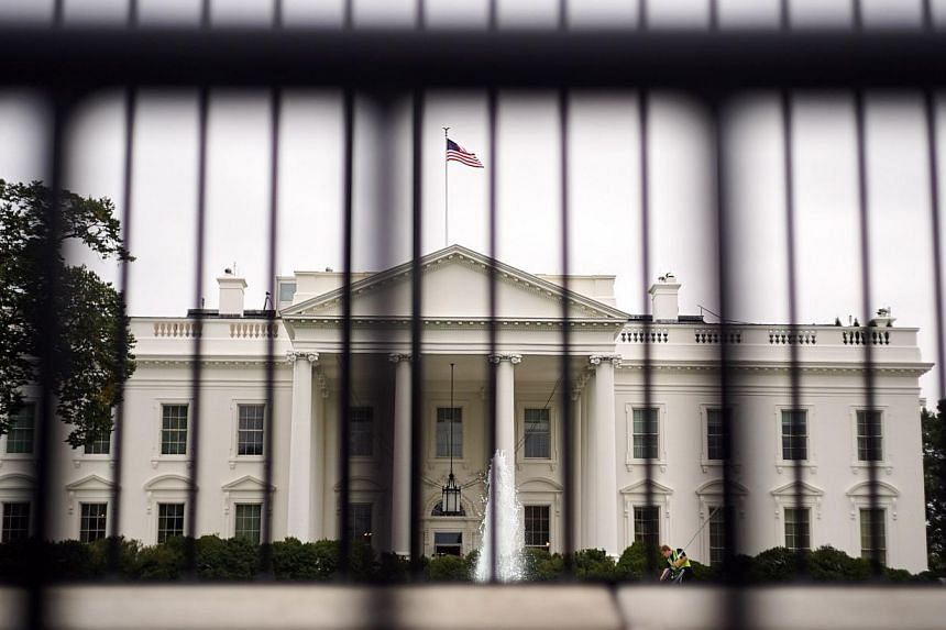 A man jumped the White House fence on Wednesday evening and was attacked by Secret Service dogs before being arrested, a Secret Service spokesman said. -- PHOTO: AFP