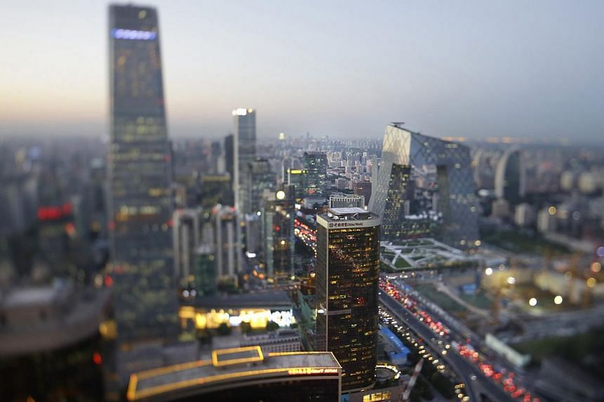 Buildings are pictured in Beijing's central business district, September 3, 2014.-- PHOTO: REUTERS