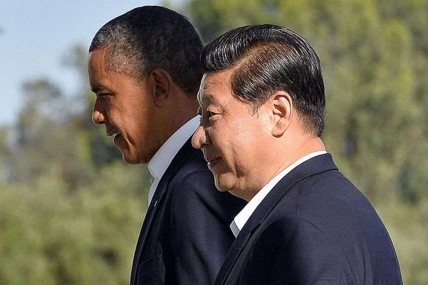 A June 7, 2013 file photo shows US President Barack Obama (left) and Chinese President Xi Jinping heading for a bilateral meeting at the Annenberg Retreat at Sunnylands in Rancho Mirage, California. -- PHOTO: AFP