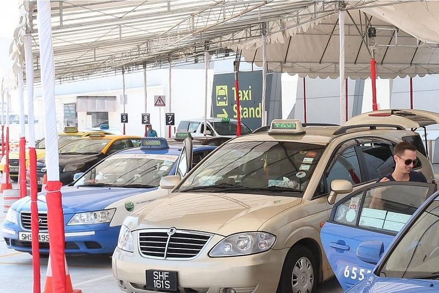The new taxi stand layout allows for more passengers to board the cabs simultaneously.-- ST PHOTO: NEO XIAOBIN