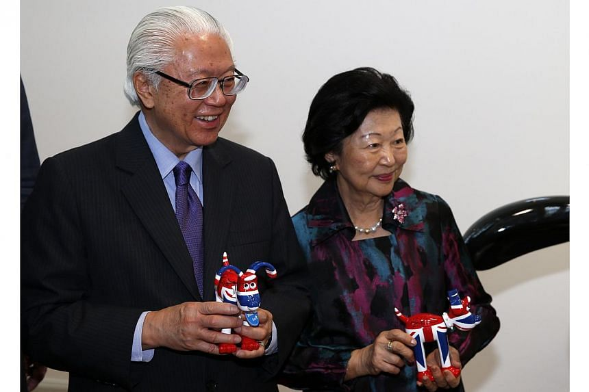 Singapore's President Tony Tan Keng Yam (left) and his wife Mary Tan hold momentos after a visit to film production company Aardman Animatons at their head office in Bristol on Oct 23, 2014. -- PHOTO: AFP