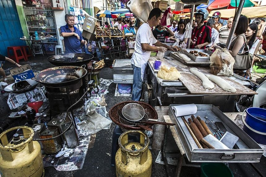 Street food hawkers in Penang, Malaysia. Penang has banned foreign workers from working as cooks in hawker food stalls, in an attempt to preserve the state's food heritage, Malaysian media reported. -- PHOTO: MARK ONG