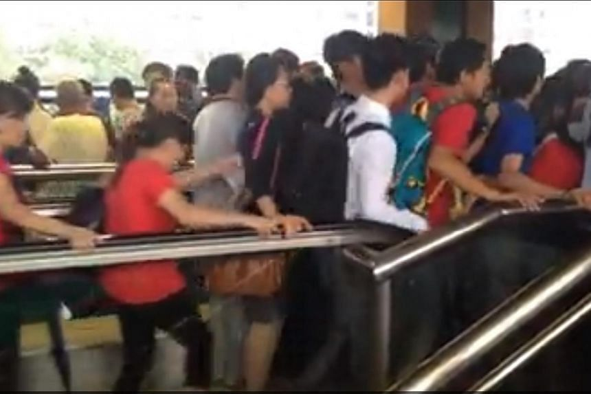 A video of people pouring onto the packed platform and jostling others when they came up on the escalator at Lakeside MRT on Tuesday has gone viral. -- SCREENGRAB: JOEL RASIS
