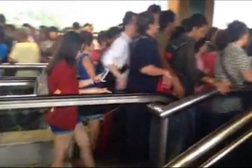 A video of people pouring onto the packed platform andjostling others when they came up on the escalator at Lakeside MRT onTuesday has gone viral.-- SCREENGRAB: JOEL RASIS