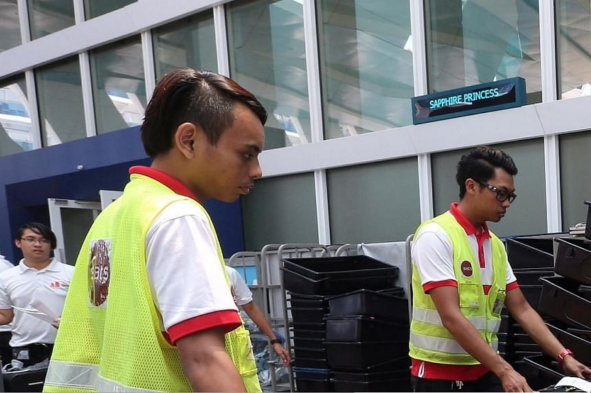 The baggage drop off counter outside the departure hall.-- ST PHOTO: NEO XIAOBIN