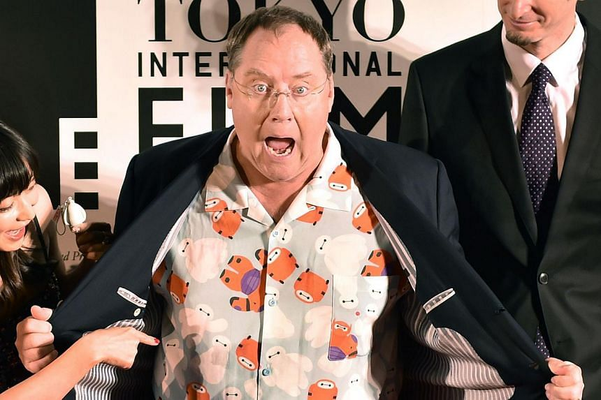 American 3D computer-animated film Big Hero 6 executive producer John Lasseter (centre), director Chris Williams (right), and Japanese actress Miho Kanno (left) pose on the red carpet for the 27th Tokyo International Film Festival opening ceremony in