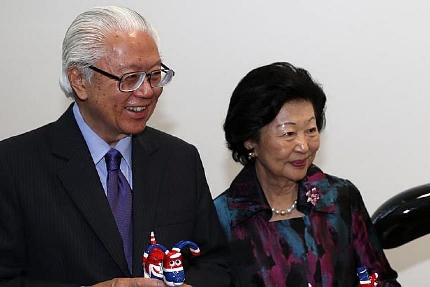 President Tony Tan Keng Yam and his wife, Mrs Mary Tan, after being presented with a keepsake by co-founders of Aardman Animatons Peter Lord (second from left) and David Sproxton (right) at their head office in Bristol on Oct 23, 2014. -- PHOTO: AFP