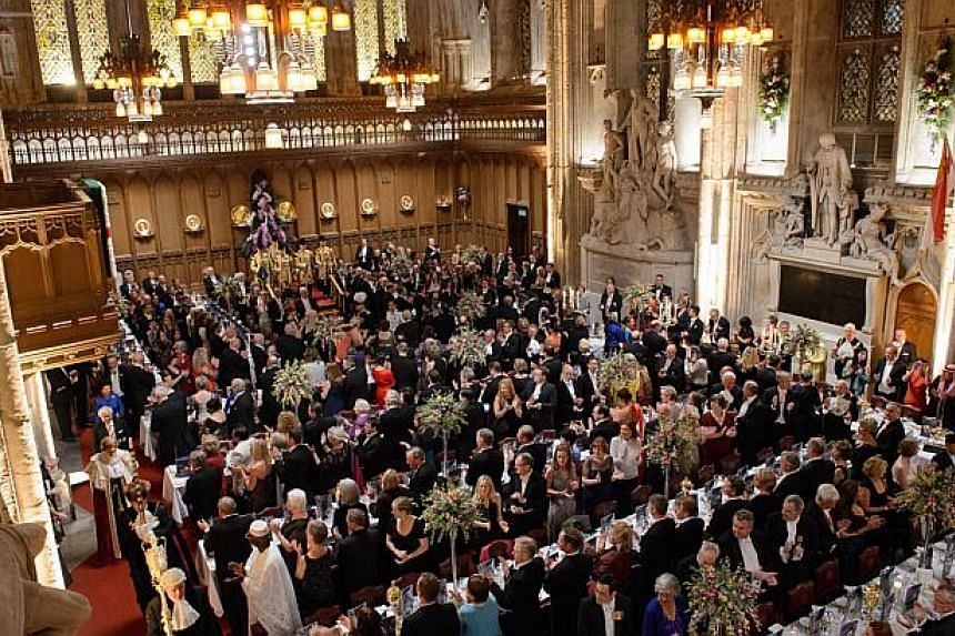 President Tony Tan Keng Yam takes part in the procession through the main hall ahead of a banquet in his honour at the Guildhall in central London on Oct 22, 2014. -- PHOTO: AFP
