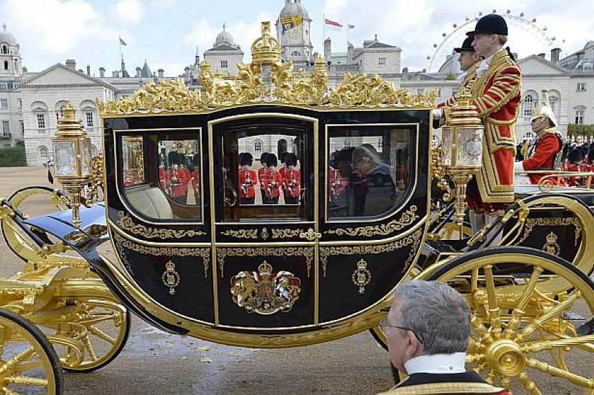 President Tony Tan Keng Yam leaves in a carriage with Britain's Queen Elizabeth II after attending a ceremonial welcome at Horse Guards Parade in London on Oct 21, 2014. -- PHOTO: REUTERS