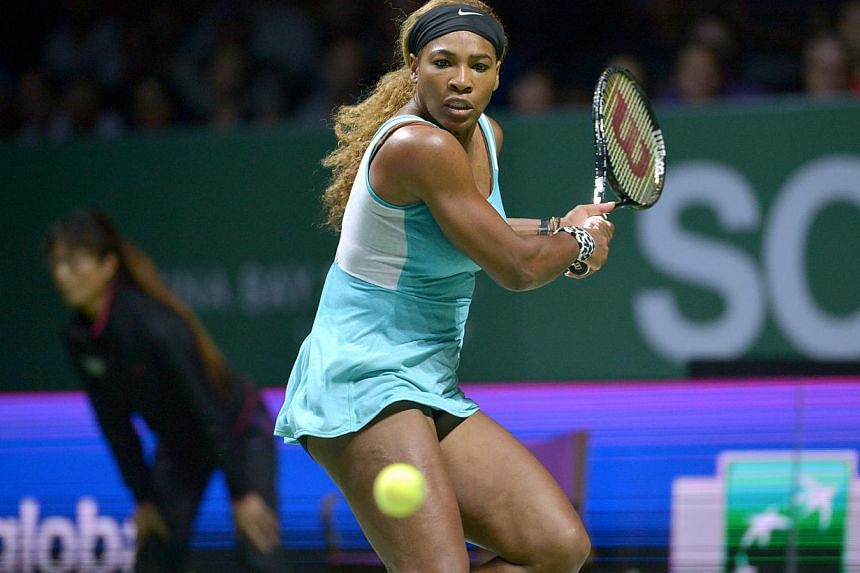 Serena Williams of the US hits a return to Simona Halep of Romania during session 3 of the WTA Finals singles tennis match held at the Singapore Indoor Stadium on Oct 22, 2014. -- ST PHOTO:KUA CHEE SIONG