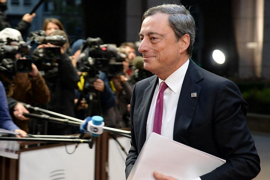 President of the European Central Bank (ECB) Mario Draghi arrives on the second day of the European Union summit at the EU headquarters in Brussels on Oct 24, 2014. -- PHOTO: AFP