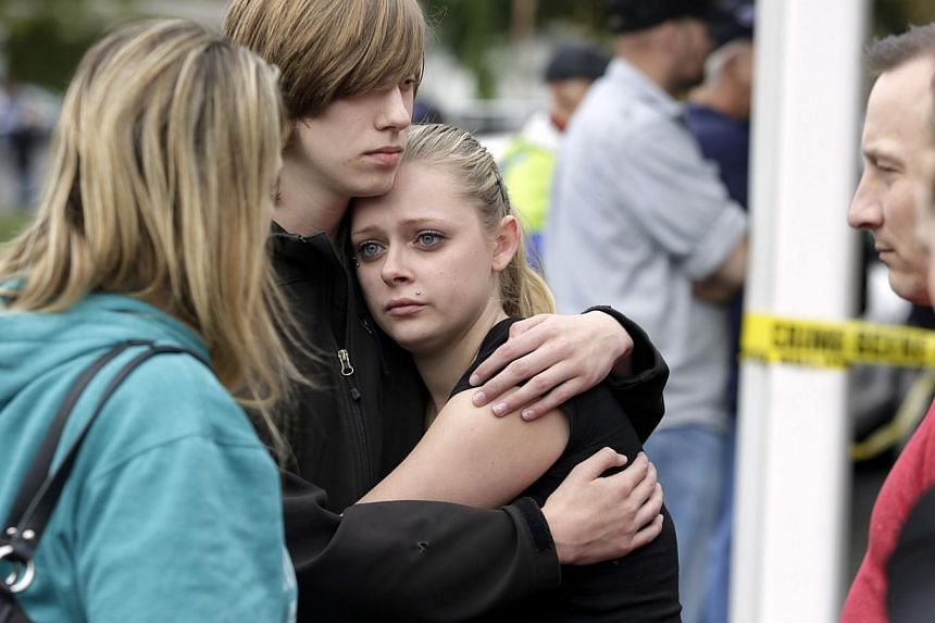 Students and family members reunite at Shoultes Gospel Hall after a student opened fire at Marysville-Pilchuck High School in Marysville, Washington on Oct 24, 2014. -- PHOTO: REUTERS