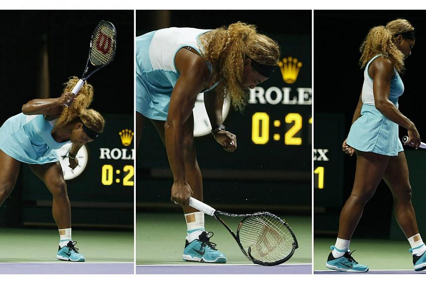 Serena Williams smashes her second racquet during her WTA Finals singles semi-finals tennis match against Caroline Wozniacki at the Singapore Indoor Stadium on Oct 25, 2014. -- PHOTO: REUTERS