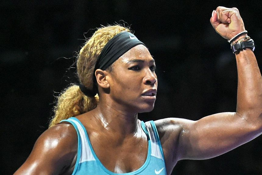 Serena Williams reacts to a point against Caroline Wozniacki during the semi-finals of the WTA Finals in Singapore on Oct 25, 2014. -- PHOTO: AFP