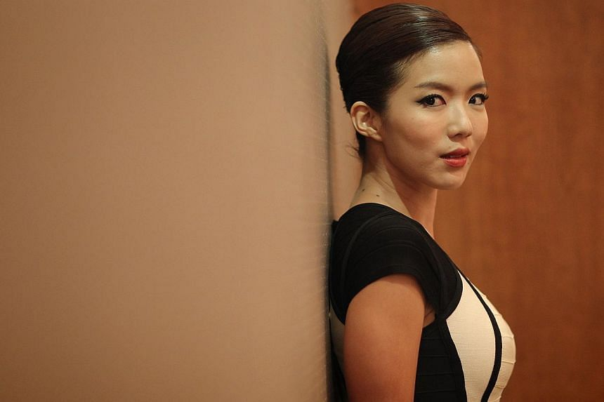 NKF's new 20-episode Channel 8 serial will feature homegrown artists Rui En (above), Dasmond Koh and Pierre Png. -- PHOTO: ST FILE