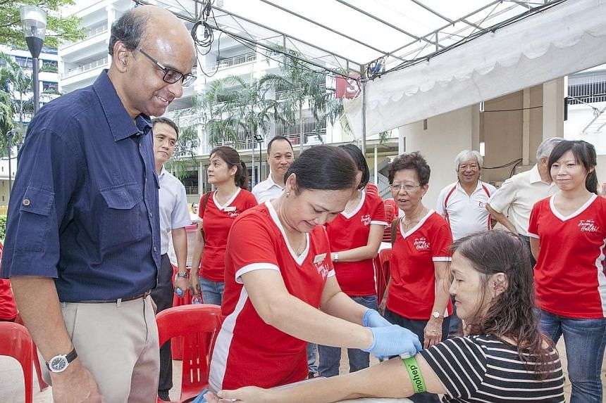 Deputy Prime Minister and Minister for Finance Tharman Shanmugaratnaminteracting with members from voluntary welfare organisations at theTaman Jurong Zone E RC Healthy Lifestyle Day on Sunday, Oct 26.A five-year, $30 million initiat