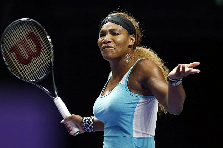 Serena Williams of the United States reacts during her women's singles final tennis match against Simona Halep of Romania at the WTA Finals at Singapore Indoor Stadium on Oct 26, 2014. -- PHOTO: REUTERS