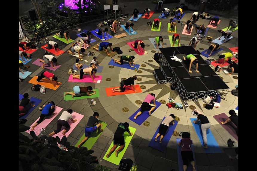 Malls are hosting free fitness classes such as yoga sessions at The Star Vista (above) and line dancing at City Square Mall. -- PHOTO: DIOS VINCOY JR FOR THE SUNDAY TIMES