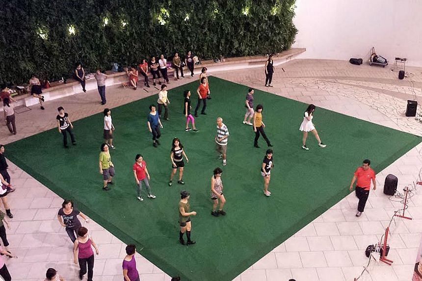 Malls are hosting free fitness classes such as yoga sessions at The Star Vista and line dancing at City Square Mall (above). -- PHOTO: YIPEE