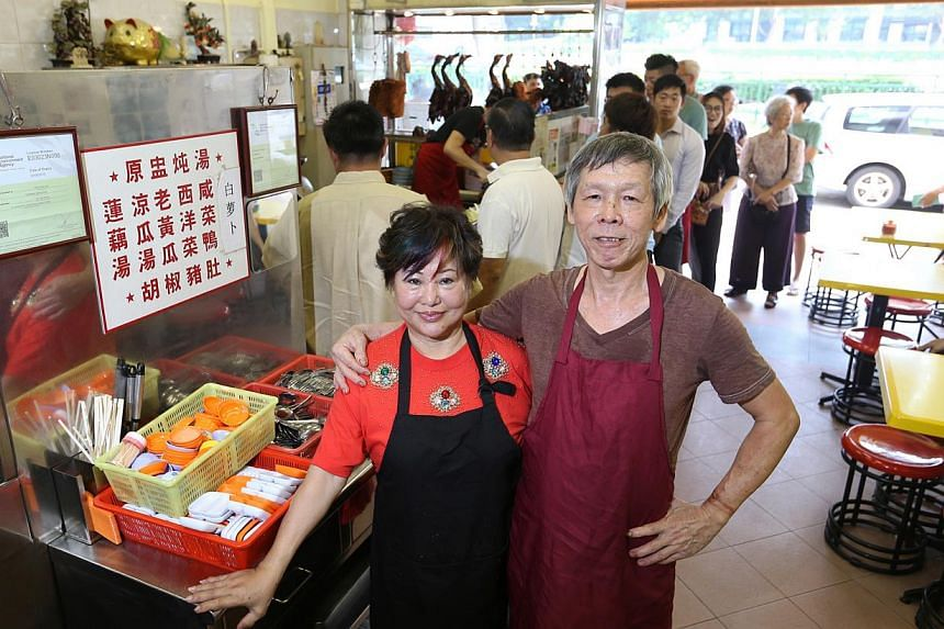 Madam Betty Kong (left, with her husband Ha Wai Kay). Their two children did not want to continue the business. -- ST PHOTO: SEAH KWANG PENG