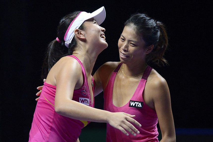 Peng Shuai (left) celebrates with doubles partner Hsieh Su-wei after winning their WTA Finals semi-final clash with Alla Kudryavtseva and Anastasia Rodionova.