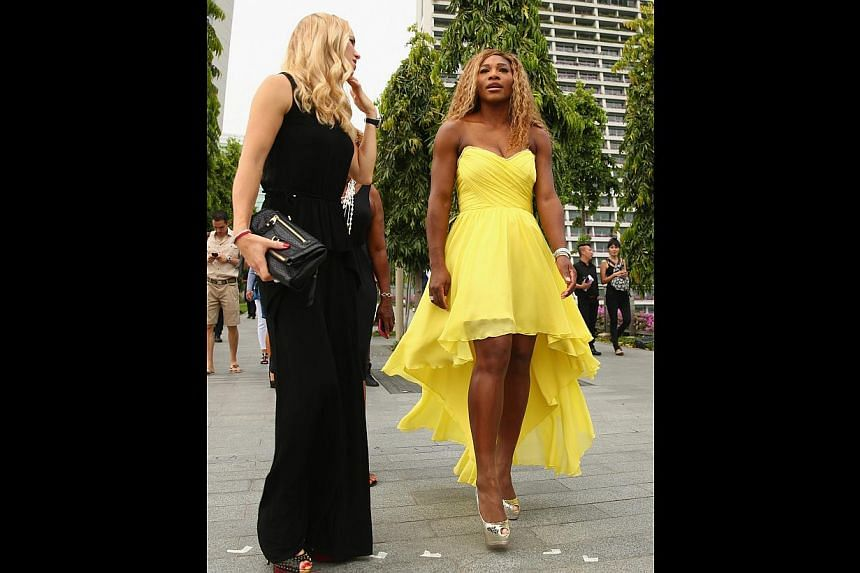 Serena Williams (right), seen here with Caroline Wozniacki, can capture the WTA Finals crown today. She says her stay in Singapore has been an eye-opener and she will be back in December for the International Premier Tennis League.