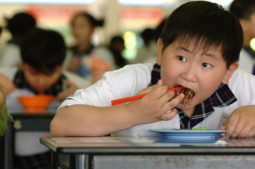 Bukit View Primary has a Model Tuckshop Programme, which promotes healthy eating. Schools are already doing their part, but healthy eating starts at home. ST PHOTO: DESMOND FOO