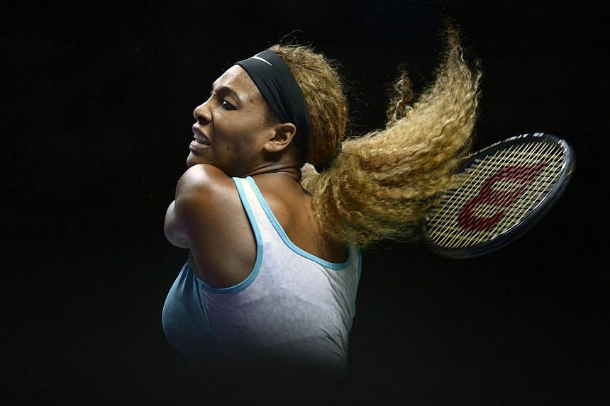 Now, a woman with a big, brassy game, on a dodgy knee, who hasn't played a full match for weeks, on a court where the ball moves slower than glaciers, finds at 33 something more in herself. -- ST PHOTO: MARK CHEONG