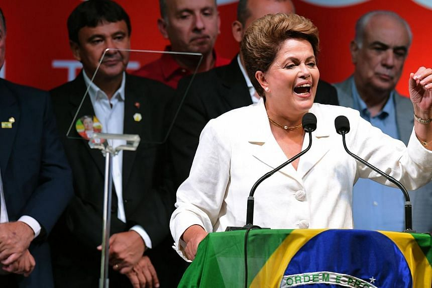 Re-elected Brazilian President Dilma Rousseff delivers a speech following her win, in Brasilia on Oct 26, 2014. -- PHOTO: AFP