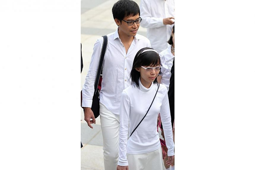 Bloggers Han Hui Hui, 22, and Roy Ngerng, 34 appeared in court on Monday to face charges of causing public nuisance and organising a demonstration without approval, during the YMCA charity carnival at Hong Lim Park, on Sept 27. -- ST PHOTO: WONG KWAI