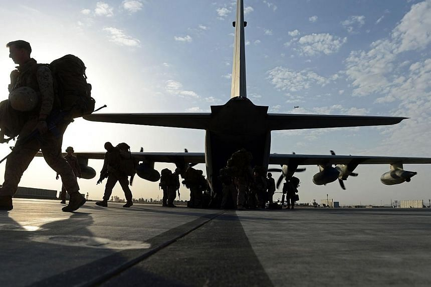 US Marines arrive in Kandahar on Oct 27, 2014, as British and US forces withdraw from the Camp Bastion-Leatherneck complex in Helmand province.A fleet of planes and helicopters airlifted the last US and British forces from a key southern provin