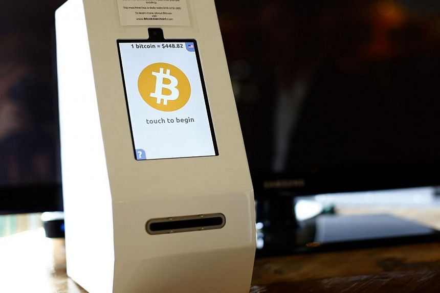 A bitcoin ATM machine is shown at a restaurant in San Diego, California on Sept 18, 2014.Blackmailers are threatening to spread Ebola in the Czech Republic unless Prague pays them a million euros' worth of the virtual Bitcoin currency, police s