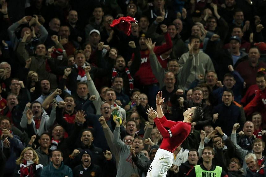Manchester United's Robin van Persie celebrates after scoring during their English Premier League football match against Chelsea at Old Trafford in Manchester, northern England on Oct 26, 2014. -- PHOTO: REUTERS