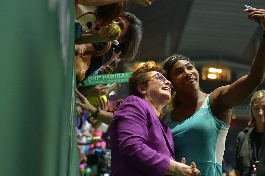 Serena Williams and Billie Jean King take a selfie together after the WTA Finals held at the Singapore Indoor Stadium on Oct 26, 2014. -- ST PHOTO: CAROLINE CHIA