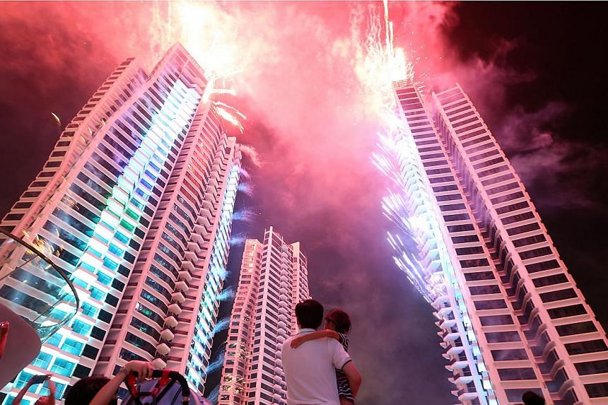 CapitaLand and Hotel Properties Limited mark the completion of the largest condominium project in Singapore - d'Leedon - with fireworks and a laser show. -- ST PHOTO:NEO XIAOBIN