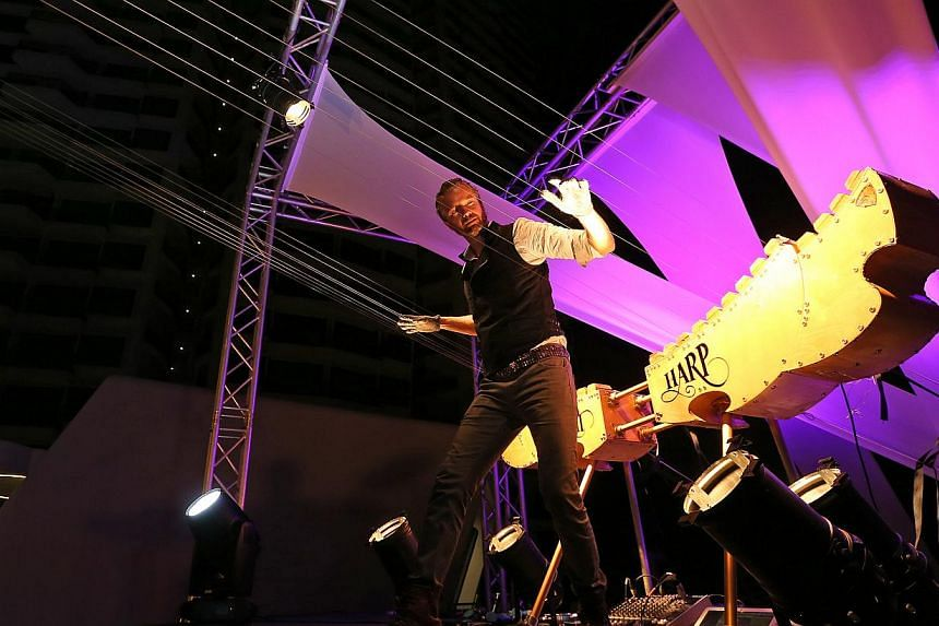 William Close, a musician of America's Got Talent fame, playing the Earth Harp, the world's longest playable stringed musical instrument.-- ST PHOTO:NEO XIAOBIN