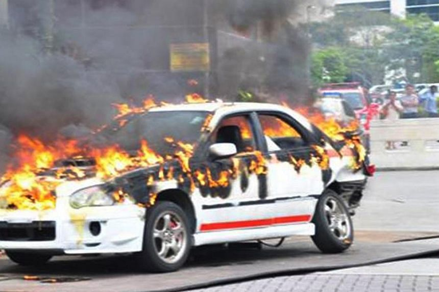 A car explodes as part of a simulated terrorist attack on the second day of Exercise Heartbeat, an annual anti-terror exercise by the Singapore Police Force at the IMM Building. -- PHOTO: SINGAPORE POLICE FORCE