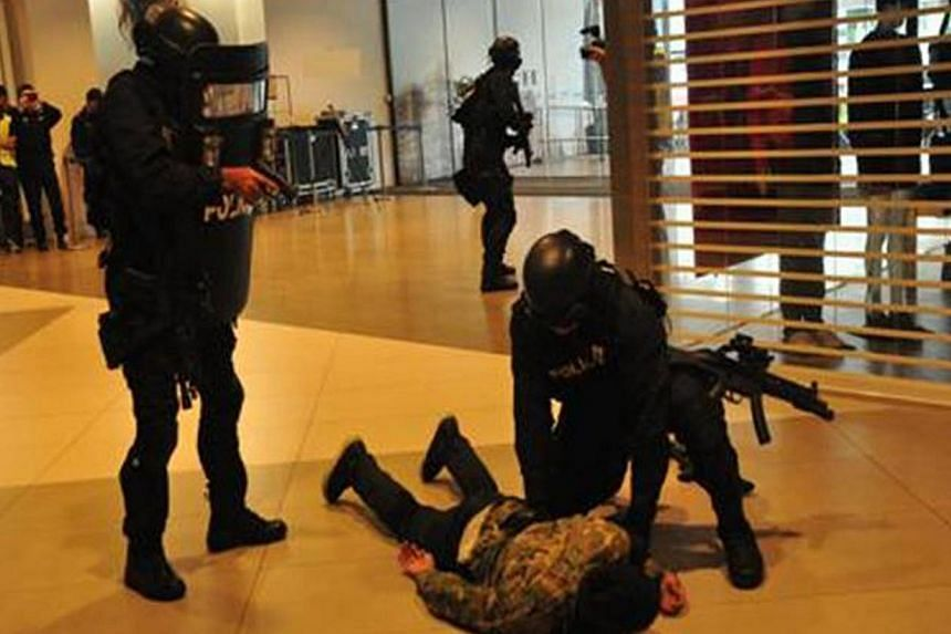 Special Operations Command (SOC) officers pin down a role player on the second day of Exercise Heartbeat, an annual anti-terror exercise by the Singapore Police Force at the IMM Building.-- PHOTO: SINGAPORE POLICE FORCE