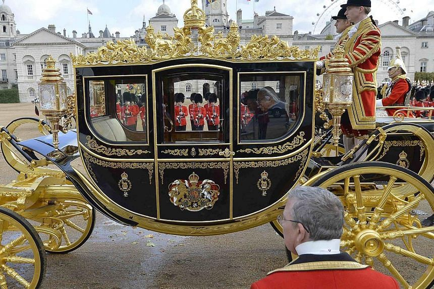 The President of Singapore Tony Tan leaves in a carriage with Britain's Queen Elizabeth after attending a ceremonial welcome at Horse Guards Parade in London on Oct 21, 2014. -- PHOTO: REUTERS
