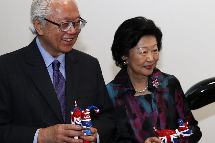 Singapore's President Tony Tan Keng Yam (left) and his wife Mary Tan hold momentos after a visit to film production company Aardman Animatons at their head office in Bristol on Oct 23, 2014, during an engagement as part of the Singaporean President's